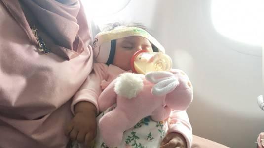 Tips Terbang Bersama Bayi yang Kolik